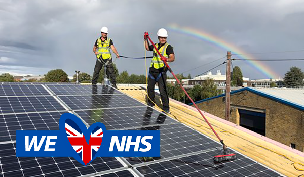 NHS employees cleaning solar panels